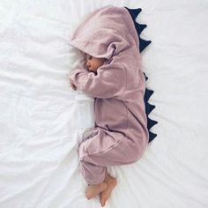 *  Zipper front<br /> * Material: 100% Cotton<br /> * Machine wash, tumble dry<br /> * Imported<br /> <br />  Cute dino hood make an adorable statement on this baby one piece.