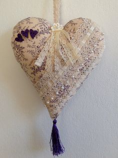 Gorgeous handmade heart. Decorated with lace, ribbon, beads, and wooden hearts. One of a kind and made with attention to detail in a smoke and pet free home.  Nice to hang on the wall or from door knobs. Perfect as a gift for someone special.  Heart measures appr. 18/20 cm. (7/ 7,8 inch)  Thanks for visiting my shop