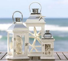 Steward of Design: My Dream Nantucket Beach Home. Cool idea to put something other than candles in a lantern. I like the starfish idea.