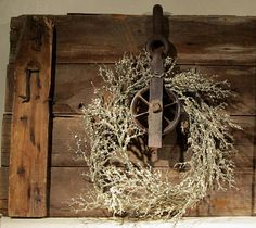 Vintage Make-Do Iron Pulley Wreath Hung on a Wooden Door
