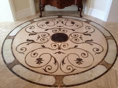 Custom Marble Medallions and Floor Decor | RESIDENTIAL it looks like there is a special stone in the middle like onyx or obsidian (that would be a cool feature0