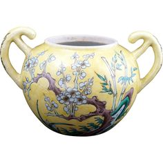 Chinese porcelain famille jeune handled bowl with hand painted designs of seasonal plants 19th century $115