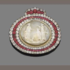 A late 18th century cameo and red foiled and colourless paste buckle depicting the education of cupid