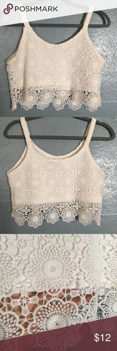 Crop Tank Cute crop tank with lace detail. This was NOT purchased at UO- i tagged it for visibility and am not sure of the brand. The tag says small, but it fit more like a medium. It was too loose on me so I didn't wear it. It's a Reposh. Urban Outfitters Tops Crop Tops