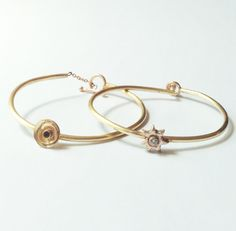 Two different types bracelets embedded with stones, but with different clasp parts.  http://www.ayakanishijewelryschoolnyc.com