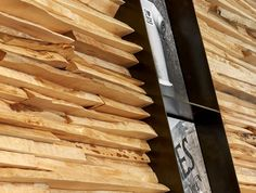 The wall is made from thousands of pieces of spalted maple wood from local scrap lumber