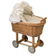 This pretty wicker doll's pram has a natural canvas hood and lining
