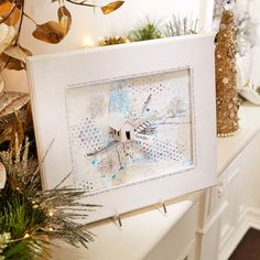 Try something unique this holiday and craft a wintry mixed media piece for your home.