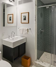 Refreshing Accent Created by Adding Orange Shades in Bathroom: Outstanding Orange Trash Bin In Modern Bathroom For Contrast ~ Treeinggear Bathrooms Inspiration