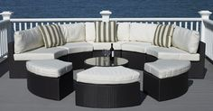 five piece round outdoor sectional with coffee table and 3 ottomans. www.madburyroad.com