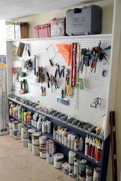 Great idea - Narrow shelves (floor to ceiling) in corner of workroom for paint