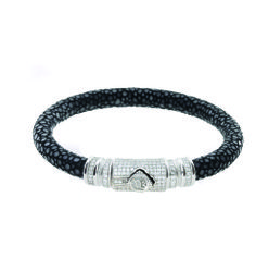 https://www.cityblis.com/2069/item/13480 | DIAMOND SIGNATURE - BRACELET - $7495 by ARSLEV JEWELRY | NOBLE BY BENDTNER  Solid Sterling Silver  340 full cut diamonds  Stingray Skin  Customize your Bracelet: Black or White Diamonds 10 different Stingray colors Accurate sizing to your wrist  Contact us to customize your bracelet | #Bracelets
