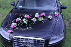 Wedding Car Decoration Mauve Ivory flowers ❤️This entire package costs $41.34. It contains: 15 bouquets made of 36 flowers to decorate the front, back & sides of the car, 4 bunches at the door, 12 sprigs of white (they can be spray painted black if the car is a light color) heart shaped twigs to decorate the front and rear of the car. The decorations are safe for car paint.❤️