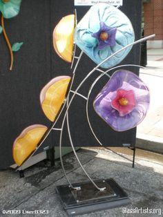 Abstract glass and metal garden sculpture