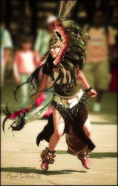 .Aztec dancer dancing her heart out.