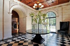 An ostentatious room given to a simple flower arrangement and nothing much else. Typical of an estate.