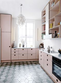 Rose Quartz is Pantone's color of the year, so it comes as no surprise that it's now popping up in kitchens everywhere. While the feminine hue is not for everyone, it's a beautiful, bold move for pastel lovers. Choose a cool dusty pink and pair with grays and burnished copper tones to offset the girly vibe.