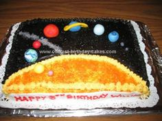 Homemade  Solar System Cake: My son created the layout (after looking at pictures of other birthday cakes online) on paper for this solar system cake for his eighth birthday party.