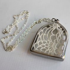 Lacey Doily Doilie Fabric Locket Style Necklace in Silver and Clear Pendant