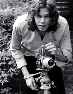 A black and white photograph of the majestic Nick Drake…taking a photograph