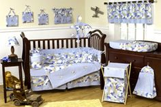 Give your little guy a nursery he can be proud of with this masculine nine-piece crib bedding set. Adorable blue camouflage adorns a complete set of crib bedding along with a throw pillow, toy bag, diaper stacker, and two window valances. Baby Boy Crib Bedding, Baby Boy Cribs, Baby Bedding Sets, Crib Sets, Nursery Bedding, Camo Nursery, Comforter Set, Themed Nursery, Themed Rooms