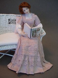 This lovely Edwardian mother doll is created from china-painted porcelain and would be about 5 and a half inches if standing, but she is