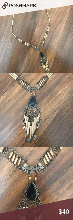 Handmade necklace Authentic handmade American Indian necklace // purchased from a festival where I watched a man make this by hand // super cool piece // a must have! // wooden beads // listed as FP for exposure Free People Jewelry Necklaces