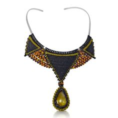 Silver and macrame necklace with Amber and Tiger's Eye stones by designer Coco Paniora Salinas of Rumi Sumaq