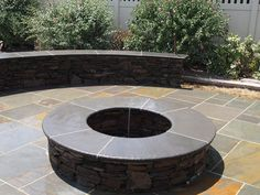 Pennsylvania Stone Seat Wall and Fire Pit with Bluestone Coping and Patio