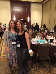 In front of my author-sponsored table, with my fabulous helper, Christina Delay. RT 2015.