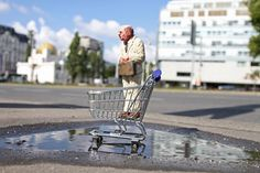 isaac cordal's miniature sculptures, cement eclipses project