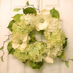 Green Hydrangea & Magnolia wreath Wr4930 - Display this lovely green hydrangea and ivory magnolia wreath all year long. Our silk like flowers are Created with high quality fabric for a natural look. Accented with soft green hydrangea leaves and wispy branches.  Measures 20""