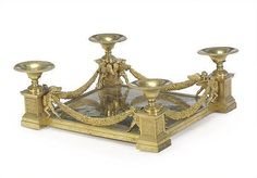 AN EMPIRE STYLE GILT METAL SURTOUT DE TABLE, <br />LATE 19TH/EARLY 20TH CENTURY <br />9½IN. (24CM.) HIGH, 49IN. (104CM.) WIDE, 24IN. (61CM.) DEEP (2)<br />