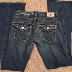 True Religion jeans size 28 Not skinny jean, distress shown is the way the jeans were made True Religion Jeans