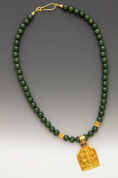 Timeless: An antique 20K-22K Indian protective plaque amulet of Bhumiya Raj on 8mm deep green jade (nephrite) beads with diamond and 18K accents. ElleSchroeder.com