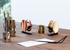 Stationery with simple shapes and metallic finishes.