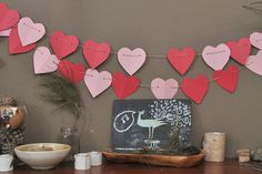 Valentine projects for kids: paper bag valentines, a heart garland, + a crafty workshop.