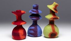 """After my terrific workshops with Catherine O'Leary this past year I played  with layers of prefelt to make these fun, very lightweight vessels. They  are about 6 inches tall when """"collapsed, and about 8 inches tall when  stretched out. The wool keeps its shape, so they can be popped back dow"""