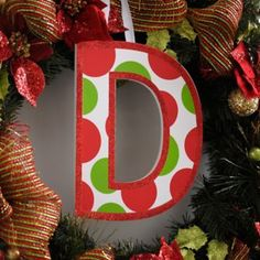 Add a personal touch to your decor with our Red & Green Polka Dot Monogram Wooden Letters! #Kirklands #holidaydecor