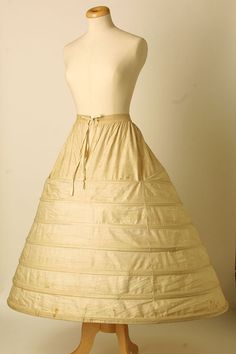 4. This cage crinoline is covered by silk and cotton. The crinoline is a device that is used to hold out women's skirts. {Crinoline 1864, Made of silk and cotton}