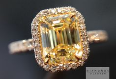 Single cut diamonds in this ring really compliment the cut of the fancy intense yellow emerald cut center stone.