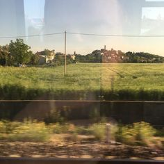 A lovely view on the train from #bologna to #rimini #travelling #goodfriends #sunshine #sun #fields by andyhaigh