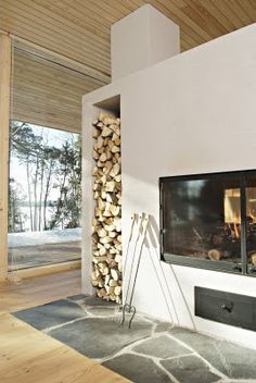Big fan of designing the fireplace to actually accommodate the wood you'll need to operate it. #prefabulous