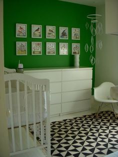 This super modern room features a kelly green accent wall, bold printed rug and Mid-century modern illustrations framed on the wall. (Not the crib of course, but like the bold colors for a small boys bedroom Green Accent Walls, Green Accents, Green Walls, Green Kids Rooms, Kid Rooms, Eames Rocker, Nursery Inspiration, Nursery Ideas, Room Ideas