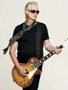 Jimmy Page. Guitar God. From the band Led Zeppelin. Still amazingly COOL>