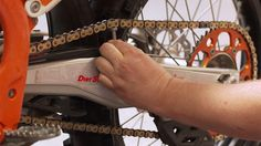 Not every chain adjustment is the same, some are slightly different. Learn how to properly adjust your chain on your KTM with Dave O'Connor. Ktm Motorcycles, Chain, Necklaces