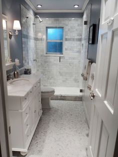 This beautiful look was created with cool colors, marble tile and a change of layout. The bathroom was originally mismatched yellow and dark orange, and the door couldn't be fully opened because a tub was in the way. Posted by RMSer KimberFL2