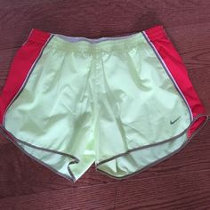 Nike Dri-fit running shorts. Yellow, white, tan and a reddish orange. These were worn only a couple of times. They are in excellent condition. Nike Shorts