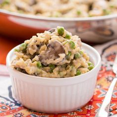 This creamy rice skillet dinner is loaded with chicken, mushroom, and peas in a creamy sauce. it is a perfect dinner for busy nights!