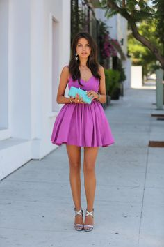 Bright clutch and purple dress